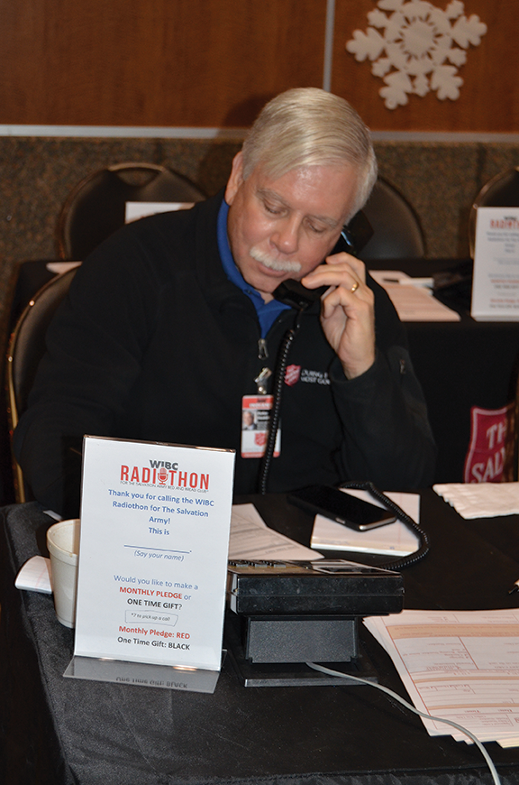 Dr. F. Duke Haddad answering the phone at a fundraiser
