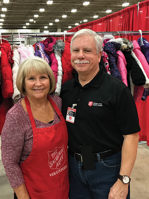 Dr. F. Duke Haddad and a Salvation Army volunteer