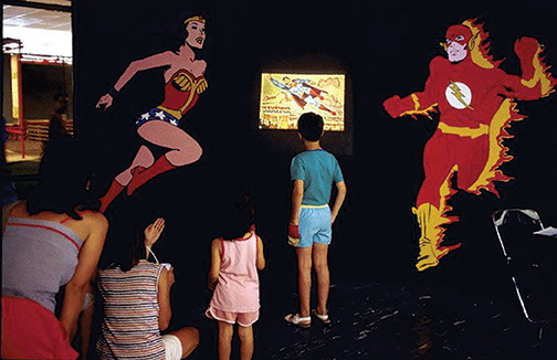 Children watching super hero movies