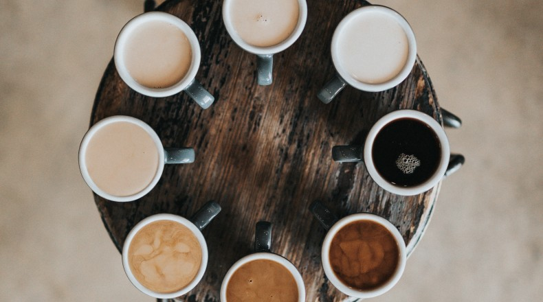 Cups of coffee varying in color