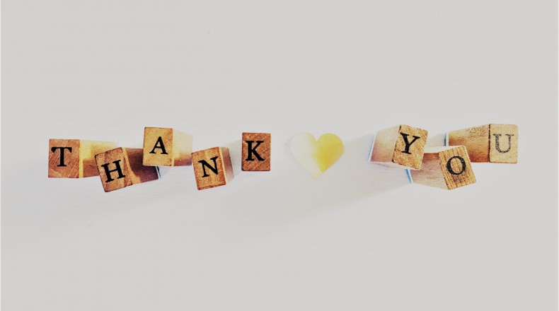 blocks spelling out thank you with a yellow paper heart in between