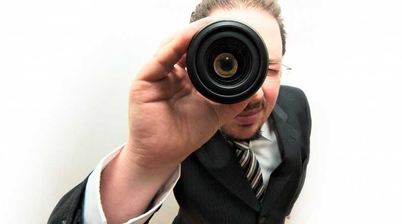 man in a suit with spyglass
