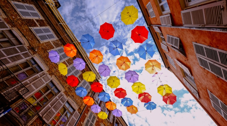 brightly colored umbrellas against the sky