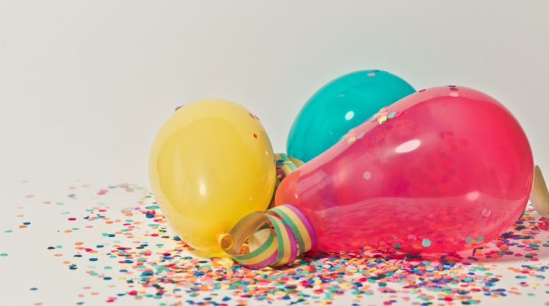 yellow, pink and blue party balloons