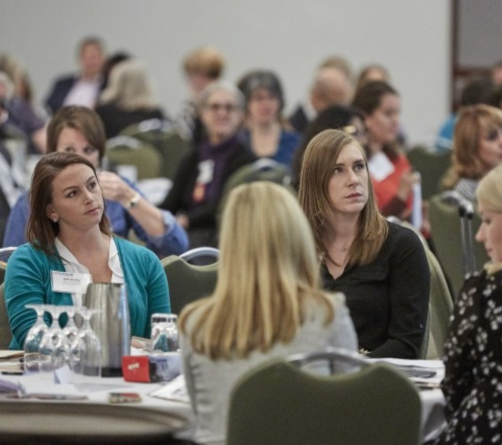 Attendees at a chapter conference listen to a speaker