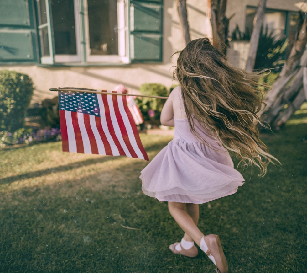 little girl holding flag