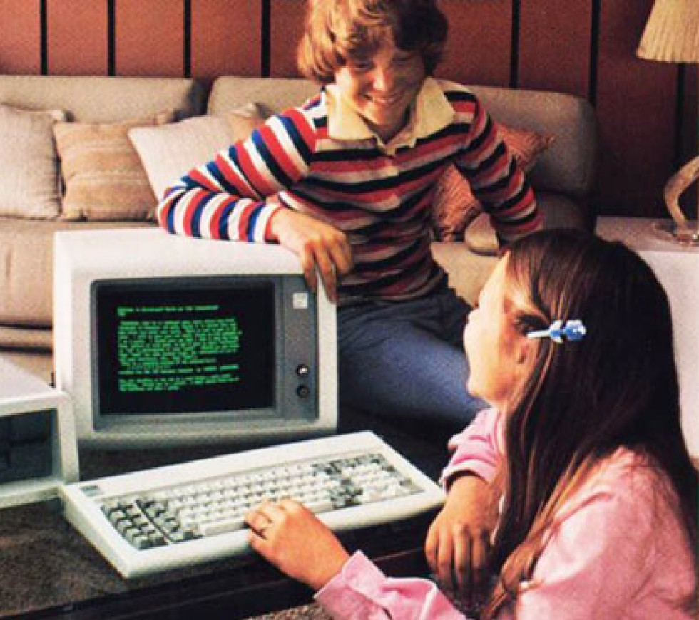 1980s family around computer