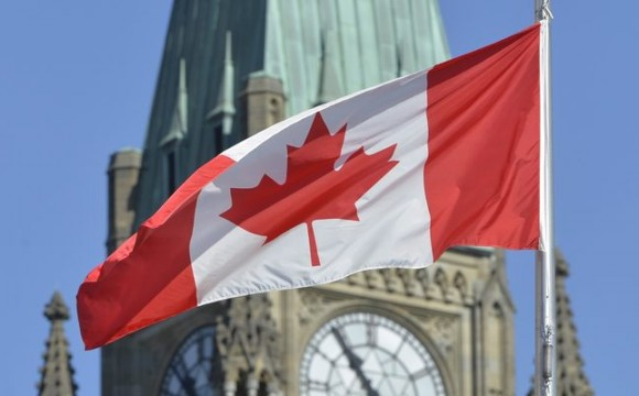 flag over Canadian parliament