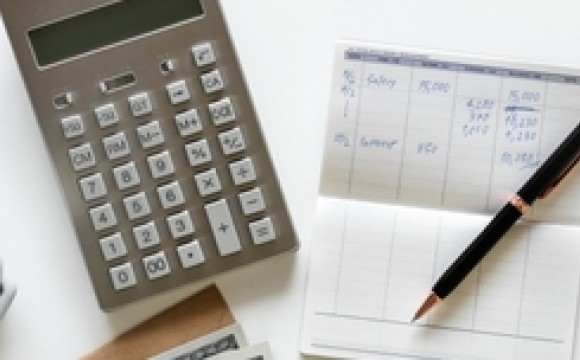 Image of calculator and spreadsheets