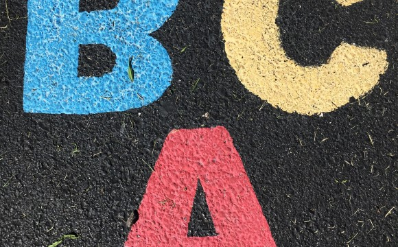 A B C written in colored chalk on ashpalt