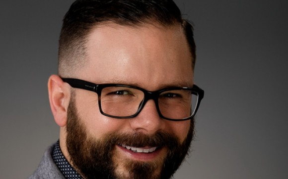 bearded man with glasses smiling