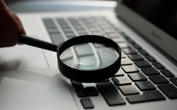 magnifying glass on a computer keyboard