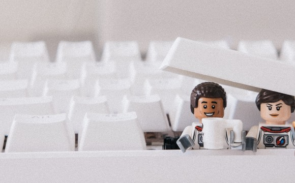 two lego people busting out of a keyboard