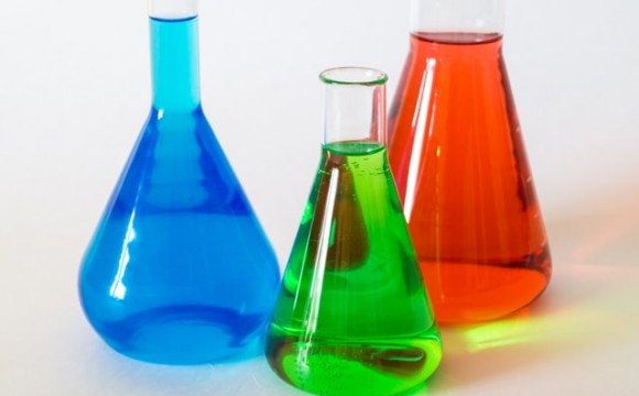 test tubes and beakers full of brightly colored liquid